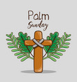 catholic cross and palm branches religion vector image