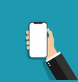 hand holds phone in a flat style mobile phone vector image