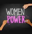 female hands writing women power slogan vector image vector image