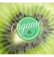 Organic food retro label kiwi blurred background vector image