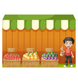 A fruit shop with a young boy wearing a red shirt vector image vector image