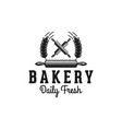 crossed rolling pin and wheat bakery logo designs vector image vector image