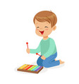cute little boy playing xylophone young musician vector image vector image
