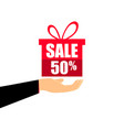 gift box on the hand with a 50 percent discount vector image vector image