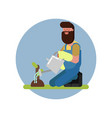 man watering the plant on his knees vector image