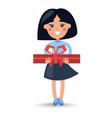 cartoon brunette girl in skirt with big giftbox vector image vector image