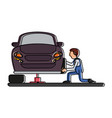 worker changing car tire workshop icon image vector image