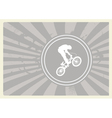 BMX cyclist on grey background