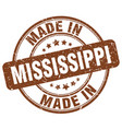 made in mississippi brown grunge round stamp vector image vector image