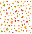 seamless pattern of autumn yellow leaves randomly vector image vector image