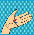 pop art hand with pills vector image