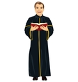 Mature christian priest in cassock holding bible vector image