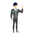 asian groom showing the victory gesture vector image vector image