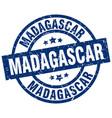 madagascar blue round grunge stamp vector image vector image