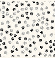 seamless pattern with chaotic animal paw vector image