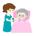 nursing assistant giving grandmother medicine vector image vector image