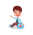 cute boy doctor in professional clothing sitting vector image vector image
