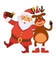 santa claus and polar deer in hat make selfie vector image