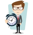 Businessman holding a clock vector image