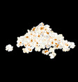 popcorn pile isolated on black vector image vector image