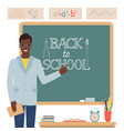a man teacher stands near school blackboard vector image