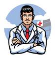 Doctor crossing arm in front of hospital badge