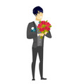 asian groom holding a bouquet of flowers vector image vector image
