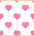 pink heart-shaped lollipops candies pattern vector image vector image