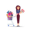 cheerful woman with shopping trolley full of gifts vector image vector image