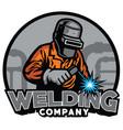 welder working with weld helmet in badge design vector image vector image