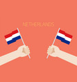 netherlands national day with hands holding up vector image vector image