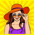 woman looks through sunglasses pop art vector image