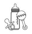 bamilk bottle with pacifier and maraca vector image vector image