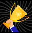 gold cup in hand vector image vector image