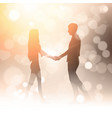 couple hold hands over bokeh background golden vector image vector image