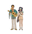 Young hippie man with guitar and woman dressed in