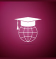 graduation cap on globe icon on purple background vector image vector image