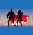superhero couple standing city silhouettes vector image vector image