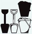 Bucket and spade with sand vector image