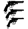 three silhouettes of retro revolvers vector image vector image