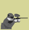 paintball player shoots from marker - paintball vector image