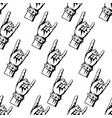 rock and roll or heavy metal hand sign pattern vector image