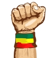 fist wearing a flag of Ethiopia wristband vector image vector image