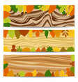 autumn banners with yellow leaves on wooden table vector image