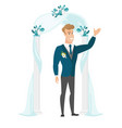 happy groom standing under the wedding arch vector image vector image