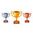 gold silver and bronze trophy cup in sartoon vector image vector image