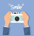 hand holding camera with smile vector image vector image
