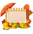 wooden fence with autumn leaves vector image