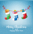 christmas greeting card with hanging socks vector image