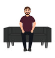 a man sits on a sofa a bearded smiling man waits vector image vector image